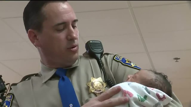 Highway patrol officer revives baby who isn't breathing after he's born on the side of the road