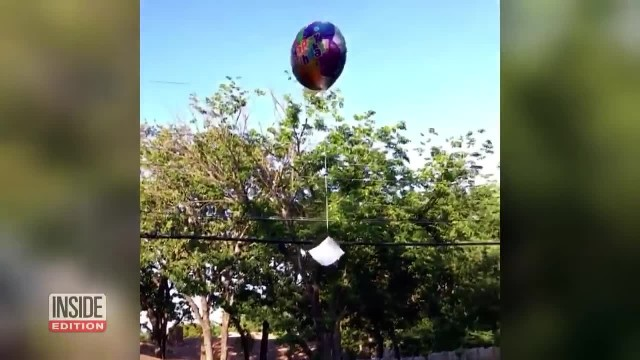 Two girls send letters on balloon to daddy in heaven. Cloud shape tells them dad is watching
