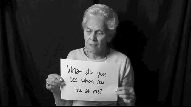 Seniors Hold Up Cards About Themselves As Powerful Reminder To Not Overlook The Elderly
