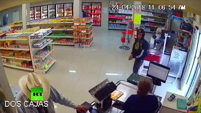 Hero cowboy calmly takes off sunglasses before pouncing on gun wielding robber