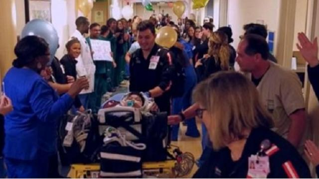 Hospital staff cheers as boy born with rare birth defect goes home after nearly two years