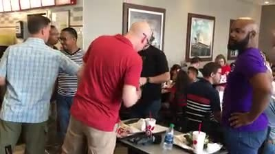 4 men stand up and start gospel flash mob at Chick-Fil-A
