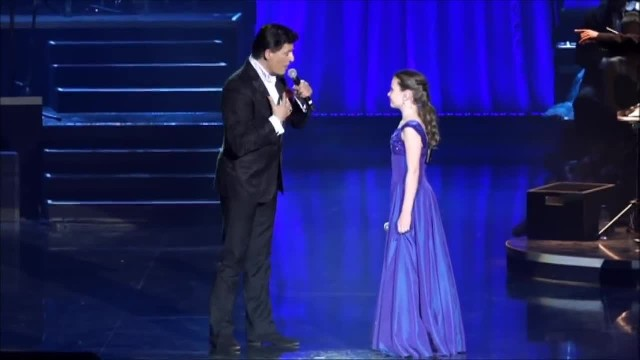 12-year-old sings song with famous singer - He drops to his knees when he hears her voice