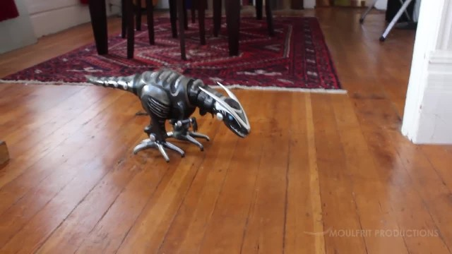 Curious kitty meets robot dinosaur for the very first time. Her reaction is priceless!