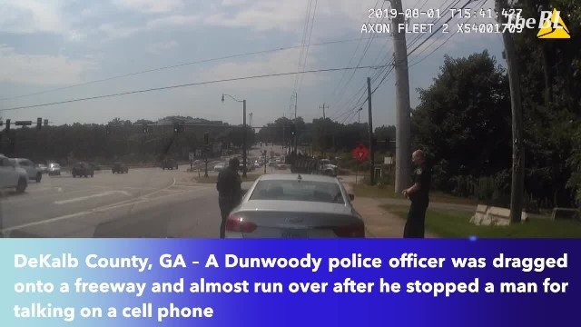 Cop Gets Dragged Down Busy Interstate After Stopping Driver For Phone Use