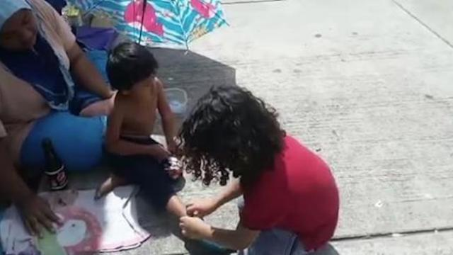 9-year-old boy gives his shoes and socks to barefooted homeless boy