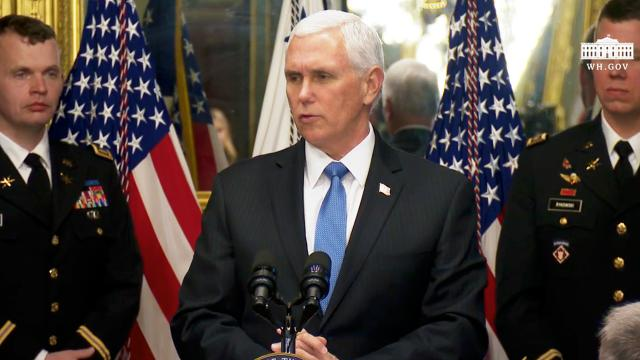 Vice President Pence presents the President's cup cybersecurity competition trophy