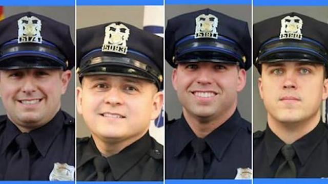 Three children saved by police officers after being tossed from 3rd story of burning apartment