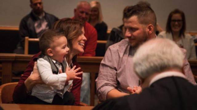 Foster kid claps and shouts out 'dad' in courtroom after being officially adopted