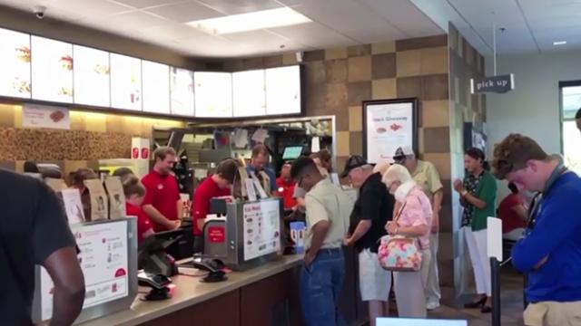 WATCH: Chick-fil-A stops during lunch rush hour, leads customers in prayer for sick employee
