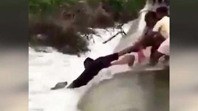 Dog swept away in flood was near giving up, til these brave heroes stepped in.