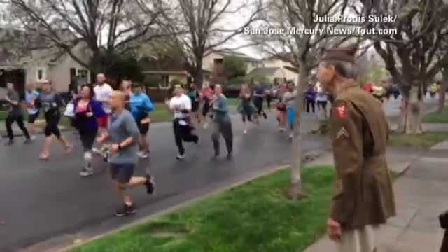 Veteran stands to watch runners as man in red starts chain reaction that goes viral