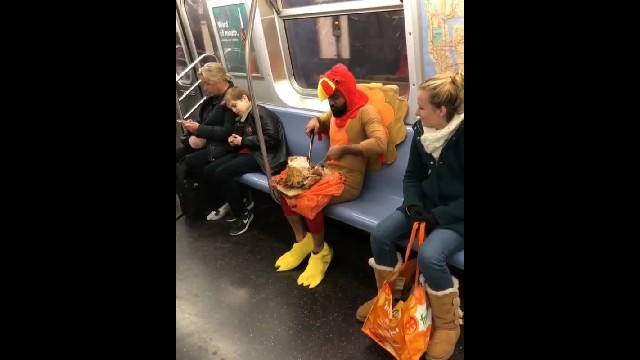 Man Dressed As a Turkey Methodically Attempts to Eat a Whole Turkey While Riding the NYC Subway