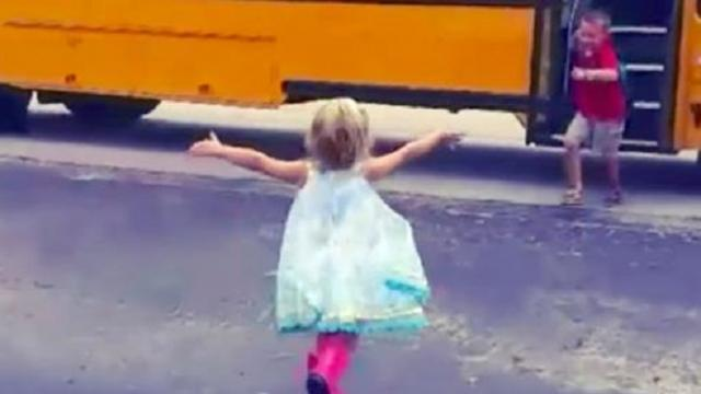 Little sister runs to hug big brother every single time the school bus drops him off